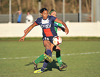 20131211 - HENIN-BEAUMONT , France :  PSG's Marie-Laure Delie pictured scoring the 0-1 for Paris despite the effort of Henin's Charlotte Blanchard (behind) during the female soccer match between FC Henin Beaumont and Paris Saint-Germain Feminin , of the Ninth matchday in the French First Female Division . Wednesday 11 December 2013. PHOTO DAVID CATRY