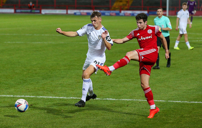 Accrington Stanley's Ryan Cassidy crosses under pressure from Leeds United U21's Harvey Sutcliffe<br /> <br /> Photographer Alex Dodd/CameraSport<br /> <br /> EFL Trophy Northern Section Group G - Accrington Stanley v Leeds United U21 - Tuesday 8th September 2020 - Crown Ground - Accrington<br />  <br /> World Copyright © 2020 CameraSport. All rights reserved. 43 Linden Ave. Countesthorpe. Leicester. England. LE8 5PG - Tel: +44 (0) 116 277 4147 - admin@camerasport.com - www.camerasport.com