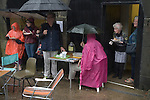 Saddleworth, Yorkshire, UK.  August Bank holiday Sunday, Saddleworth Morris men are performing, tea is being served in pouring rain.