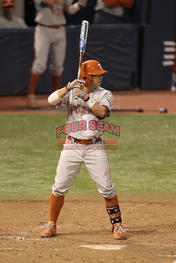 Texas Longhorns shortstop C.J. Hinojosa #9 bats during a game against the Minnesota Golden Gophers at the Metrodome on March 22, 2013 in Minneapolis, Minnesota. (Brace Hemmelgarn/Four Seam Images)