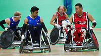15 AUG 2011 - LEEDS, GBR - Canada's Garett Hickling (second from right) looks for a way through to the Great Britain goal line during the wheelchair rugby exhibition match between the two teams .(PHOTO (C) NIGEL FARROW)