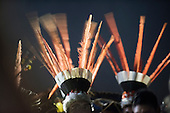 Indigenous warriors dance with their feather headdresses at the Fire ceremon to open the first ever International Indigenous Games, in the city of Palmas, Tocantins State, Brazil. Photo © Sue Cunningham, pictures@scphotographic.com 22nd October 2015