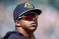 Luis Medina (30) of the Charleston RiverDogs watches the action from the dugout during the game against the Hickory Crawdads at L.P. Frans Stadium on May 13, 2019 in Hickory, North Carolina. The Crawdads defeated the RiverDogs 7-5. (Brian Westerholt/Four Seam Images)