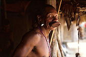 Kubenkokre Village, Brazil. Bote Kayapo with traditional lip plate and ear plugs; Xingu.
