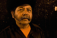 """Portrait of a """"Trio"""" member. <br /> <br /> In northern mexico bands known as """"trios"""" are well known for their services, private playings. In restaurants, bars or in the street is often see them offering songs, from traditional mexican music like mariachis, banda, corridos to classic rock."""