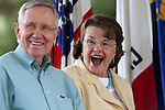 U.S. Senate Majority Leader Harry Reid and Sen. Dianne Feinstein laugh at a joke at the 18th annual Lake Tahoe Summit at the Valhalla Estate in South Lake Tahoe, Ca., on Tuesday, Aug. 19, 2014. <br /> Photo by Cathleen Allison