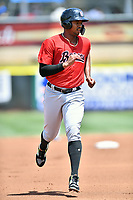 Birmingham Barons left fielder Eloy Jimenez (21) runs to third base during a game against the Tennessee Smokies at Smokies Stadium on May 6, 2018 in Kodak, Tennessee. The Smokies defeated the Barons 6-2. (Tony Farlow/Four Seam Images)