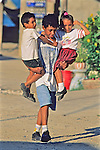 Young Man Carrying Two Children