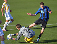 Miramar's Patrick Fleming makes contact with keeper Blaz Bugarin before being sent off during the Chatham Cup semifinal football match between  Miramar Rangers and Central United at David Farrington Park, Wellington, New Zealand on Sunday, 5 August 2012. Photo: Dave Lintott / lintottphoto.co.nz