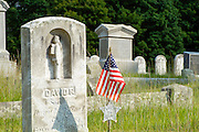 Old weathered headstones at Chester Village Cemetery in Chester, New Hampshire USA.