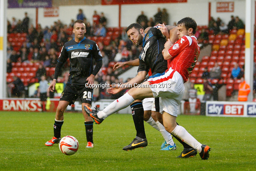 Jon Ashton of Stevenage battles with Andy Taylor of Walsall<br />  - Walsall v Stevenage - Sky Bet League One - Banks's Stadium, Walsall - 19th October 2013. <br /> © Kevin Coleman 2013