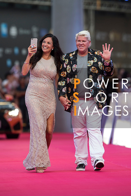 John Daly of USA and his partner walks the Red Carpet event at the World Celebrity Pro-Am 2016 Mission Hills China Golf Tournament on 20 October 2016, in Haikou, China. Photo by Victor Fraile / Power Sport Images