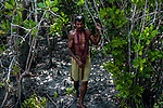 A honey collector walks alone through the dense forest of Sunderbans. Walking alone in these areas make honey collectors vulnerable to tiger attack. Sunderbans, West Bengal, India. Arindam Mukherjee
