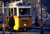 Budapest, Hungary. Yellow tram No 49 at the stop; people waiting.