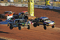 Dec. 10, 2011; Chandler, AZ, USA;  LOORRS pro 2 unlimited driver Greg Adler (10) and Jeremy McGrath (2) during round 15 at Firebird International Raceway. Mandatory Credit: Mark J. Rebilas-