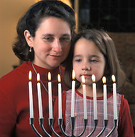Mother with Daughter looking at Menorah