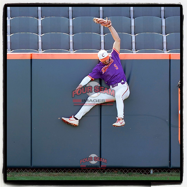 Clemson Tigers outfielder Sam Hall (5) reaches in vain for a home run ball hit by Bo Majkowski in a fall Orange-Purple intrasquad scrimmage on Saturday, November 14, 2020, at Doug Kingsmore Stadium in Clemson, South Carolina. (Tom Priddy/Four Seam Images)