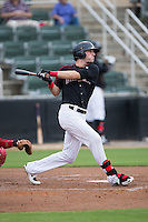 Louie Lechich (21) of the Kannapolis Intimidators follows through on his swing against the Lakewood BlueClaws at Intimidators Stadium on July 14, 2015 in Kannapolis, North Carolina.  The Intimidators defeated the BlueClaws 8-2.  (Brian Westerholt/Four Seam Images)