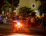 DEL MAR, CA - SEPTEMBER 02: A motorcycle officer rides by as fans wait in line after shots were fired by a suspect and the suspect was shot by at least one San Diego Sheriff's deputy before an Ice Cube concert at Del Mar Race Track on September 2, 2018 in Del Mar, California (Photo by Casey Phillips/Eclipse Sportswire/Getty Images)