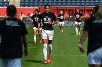 BRIDGEVIEW, IL - JULY 18: Alana Cook #4 of the OL Reign warms up before a game between OL Reign and Chicago Red Stars at SeatGeek Stadium on July 18, 2021 in Bridgeview, Illinois.