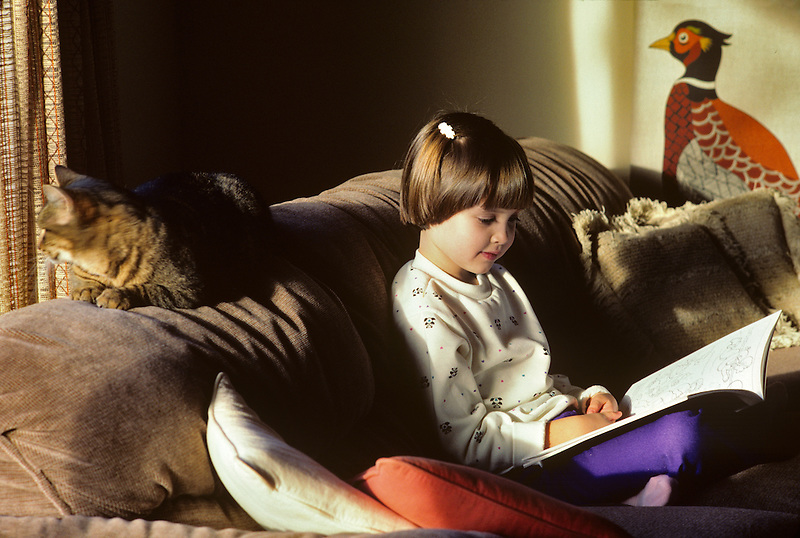 Child reading book. Monroe, Oregon.