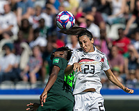 GRENOBLE, FRANCE - JUNE 22: Uchenna Kanu #12 of the Nigerian National Team, Sara Doorsoun #23 of the German National Team battle for head ball during a game between Nigeria and Germany at Stade des Alpes on June 22, 2019 in Grenoble, France.