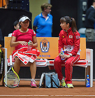 The Netherlands, Den Bosch, 20.04.2014. Fed Cup Netherlands-Japan, Kurumi Nara (JPN) on the bench with captain Yuka Kaneko<br /> Photo:Tennisimages/Henk Koster