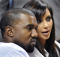 MIAMI, FL - DECEMBER 06: Kanye West and Kim Kardashian attend the game between the New York Knicks and Miami Heat at American Airlines Arena on December 6, 2012 in Miami, Florida.  <br /> CAP/MPI122<br /> ©MPI122/Capital Pictures