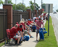 University of Arkansas baseball fans visit Friday, June 4, 2021, while lining up along 15th Street hours before the gates open to see the Razorbacks' game with New Jersey Institute of Technology in the first round of the Fayetteville Regional at Baum-Walker Stadium in Fayetteville. The Regional continues today. Visit nwaonline.com/210605Daily/ for today's photo gallery.<br /> (NWA Democrat-Gazette/Andy Shupe)