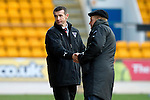 St Johnstone v Dunfermline....25.02.12   SPL.Jim McIntyre shakes hands with Steve Lomas at full time.Picture by Graeme Hart..Copyright Perthshire Picture Agency.Tel: 01738 623350  Mobile: 07990 594431
