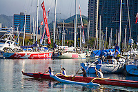Women paddling outrigger canoe at Ala Wai Yacht Harbor in Honolulu, Oahu Hawaii