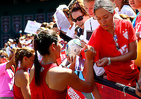WASHINGTON D.C. - September 02, 2013:<br /> Yael Averbuch signs a fans shirt sleeve During a USA WNT open practice at RFK Stadium, in Washington D.C. the day before the USA v Mexico international friendly match.