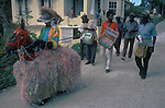BARBADOS HOBBY HORSE WEST INDIES .<br /> The music that the attendants play and the way the Hobby Horse prances about is very similar to both the Padstow Hobby Horse, Cornwall, England, the Minehead Hobby Horse and the Dunster Hobby Horse Somerset UK.  Attendants playing drums accompany both Minehead and the Dunster Horse. This Hobby Horse looks much more like the Minehead Horse and Dunster Horse and perhaps was brought to the West Indies by sailors from Great Britain. 1970s