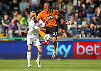 11th September 2021; Swansea.com Stadium, Swansea, Wales; EFL Championship football, Swansea versus Hull City; Josh Magennis of Hull City controls the ball while under pressure from Flynn Downes of Swansea City