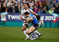 Photo: Richard Lane/Richard Lane Photography. Bath Rugby v Leinster. Heineken Cup. 11/12/2011. Bath's Olly Barkley is tackled by Leinster's Isa Nacewa.