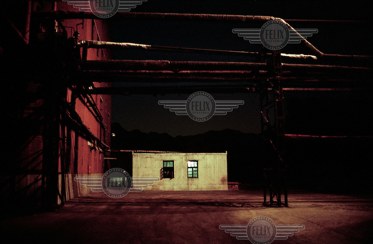 The grounds of a small coal coking plant at night. China is one of the world's largest producers and consumers of coke fuel. It is also one of the world's largest producers of both carbon and sulphur dioxide.