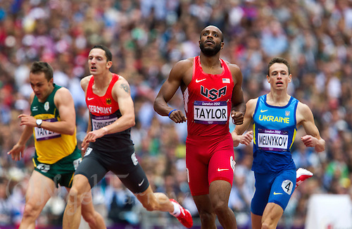 03 AUG 2012 - LONDON, GBR - Angelo Taylor (USA) (second from right) of the USA recovers after finishing his men's 400m hurdles heat during the London 2012 Olympic Games athletics at the Olympic Stadium in the Olympic Park in Stratford, London, Great Britain .(PHOTO (C) 2012 NIGEL FARROW)