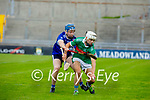 Crotta James Sheehan been well marked by Padraig O'Sullivan of St Brendan's in the County Senior Hurling Championship quarter final