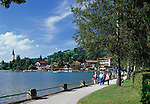 Germany, Bavaria, Upper Bavaria, Schliersee: small town and popular climatic health resort with St. Sixtus Church at Lake Schliersee, seaside promenade