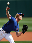 Mike Foltynewicz pitches in a spring training game between the Texas Rangers and Los Angeles Dodgers in Surprise, Ariz., on Sunday, March 7, 2021.<br /> Photo by Cathleen Allison