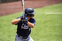 Liberty Flames third baseman Trey McDyre (5) at bat against the Duke Blue Devils in NCAA Regional play on Robert M. Lindsay Field at Lindsey Nelson Stadium on June 4, 2021, in Knoxville, Tennessee. (Danny Parker/Four Seam Images)
