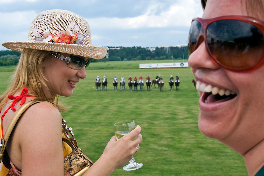 Nikolina Gora, Moscow Region, Russia, 25/06/2005..The Russian Polo Cup 2005, organised by the Russian Federation of Polo Players and the Moscow Polo Club. Guests in the VIP area enjoy the hospitality suites while watching the matches.