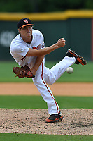 Pitcher Robert Broome (7) of the Mercer Bears delivers a pitch in a game against the VMI Keydets as part of the Southern Conference Championship series on Wednesday, May 24, 2017, at Fluor Field at the West End in Greenville, South Carolina. Mercer won, 11-6. (Tom Priddy/Four Seam Images)