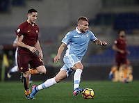 Calcio, Serie A: Roma, stadio Olimpico, 1marzo 2017.<br /> Lazio's Ciro Immobile (r) in action with Roma's Kostas Manolas (l) during the Italian TIM Cup 1st leg semifinal football match between Lazio and AS Roma at Rome's Olympic stadium, on March 1, 2017.<br /> UPDATE IMAGES PRESS/Isabella Bonotto