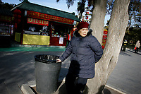 CHINA. An old woman during Chinese New Year in Ditan Park in Beijing.  Chinese New Year, or Spring Festival, is the most important festival and holiday in the Chinese calendar In mainland China, many people use this holiday to visit family and friends and also visit local temples to offer prayers to their ancestors. The roots of Chinese New Year lie in combined influences from Buddhism, Taoism, Confucianism, and folk religions.  2008