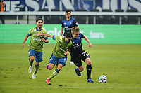 SAN JOSE, CA - OCTOBER 18: Alex Roldan #16 of the Seattle Sounders battles for the ball with Tommy Thompson #22 of the San Jose Earthquakes during a game between Seattle Sounders FC and San Jose Earthquakes at Earthquakes Stadium on October 18, 2020 in San Jose, California.