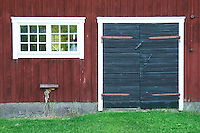 Traditional style Swedish wooden painted house. Black door. Window Barn Smaland region. Sweden, Europe.