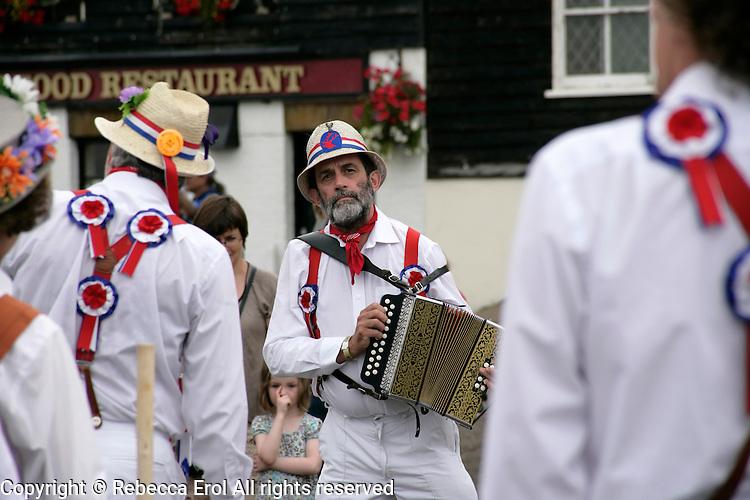 Concertina player with morris dancers at Broadstairs, Kent, UK