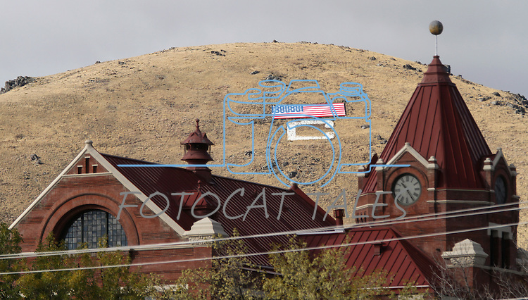 The 65' by 120' American flag on C Hill is seen above the Paul Laxalt Building, in downtown Carson City, Nev., on Monday, Oct. 25, 2010. The flag was constructed following Sept. 11, 2001 to show community patriotism..Photo by Cathleen Allison