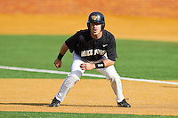 Pat Blair #11 of the Wake Forest Demon Deacons takes his lead off of first base against the Miami Hurricanes at Gene Hooks Field on March 19, 2011 in Winston-Salem, North Carolina.  Photo by Brian Westerholt / Four Seam Images